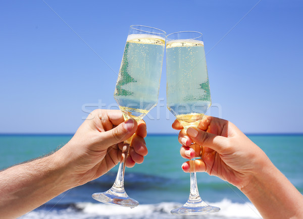 Two champagne glasses in man and woman hands Stock photo © dashapetrenko
