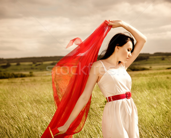 Brunette girl with red fabric in summer day Stock photo © dashapetrenko