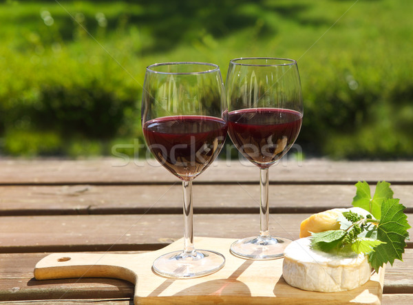 Various sorts of cheese and two glasses of the natural homemade  Stock photo © dashapetrenko