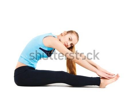 Blond young woman doing her yoga stretch Stock photo © dashapetrenko