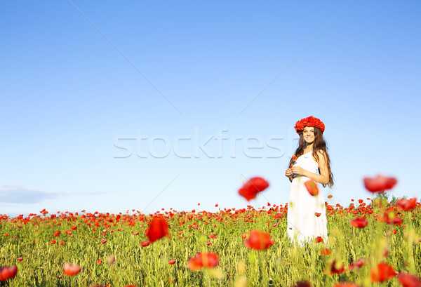 Young happy woman in poppy field Stock photo © dashapetrenko