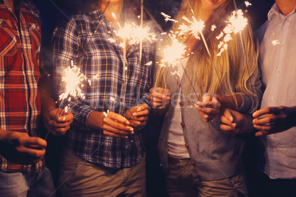 People with sparklers on outdoor party Stock photo © dashapetrenko