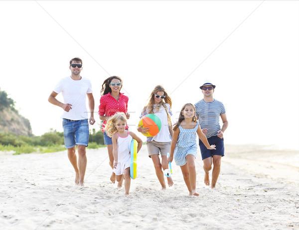 Group of young people with kids on the beech Stock photo © dashapetrenko