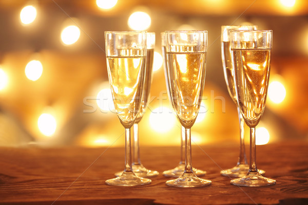 Champagne glasses on golden background  Stock photo © dashapetrenko