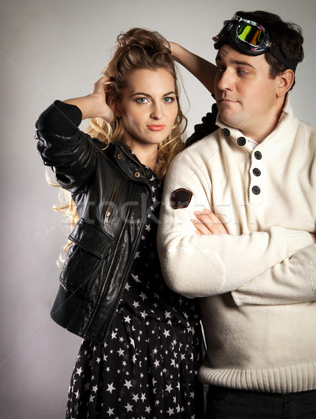 Young couple in retro style clothes over light background Stock photo © dashapetrenko