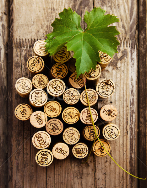Stock photo: Dated wine bottle corks on the wooden background