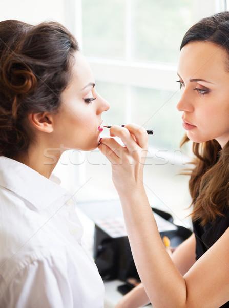 Make-up artist doing make up for young beautiful bride  Stock photo © dashapetrenko