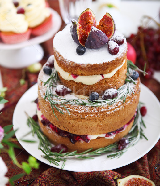 Dessert table for a wedding. Cake, cupcakes, sweetness, fruits a Stock photo © dashapetrenko