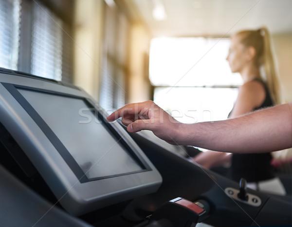 Healthy couple running on a treadmill Stock photo © dashapetrenko