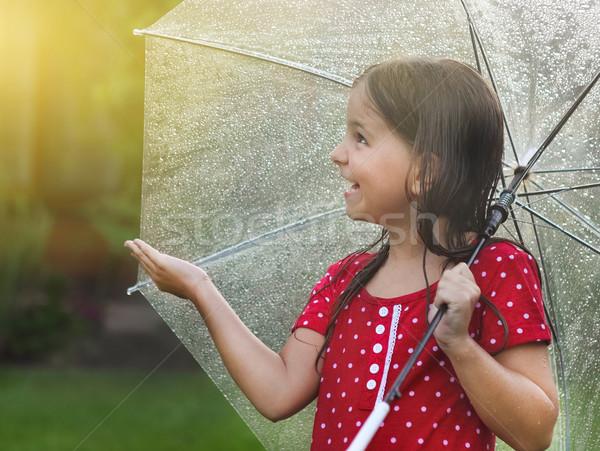 Child wearing polka dots dress under umbrella in rainy day Stock photo © dashapetrenko