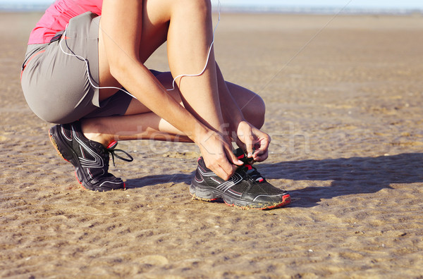 Young woman runner tying shoelaces Stock photo © dashapetrenko