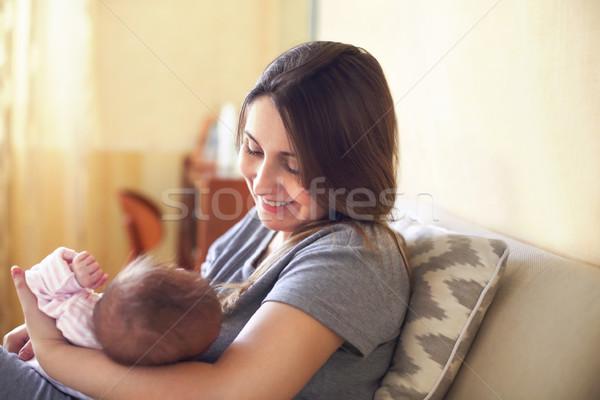 Young mother holding her newborn child. Mom nursing baby. Stock photo © dashapetrenko