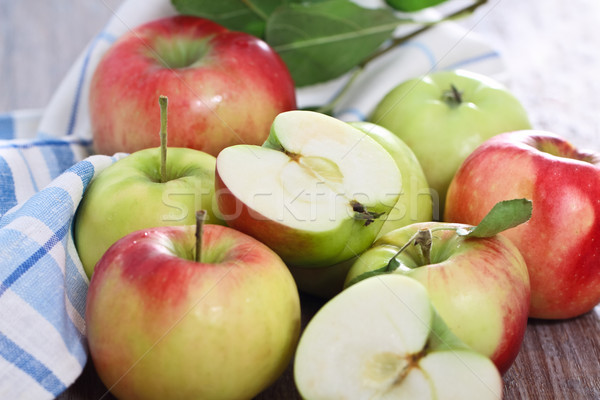Red and green apples with leaves Stock photo © dashapetrenko