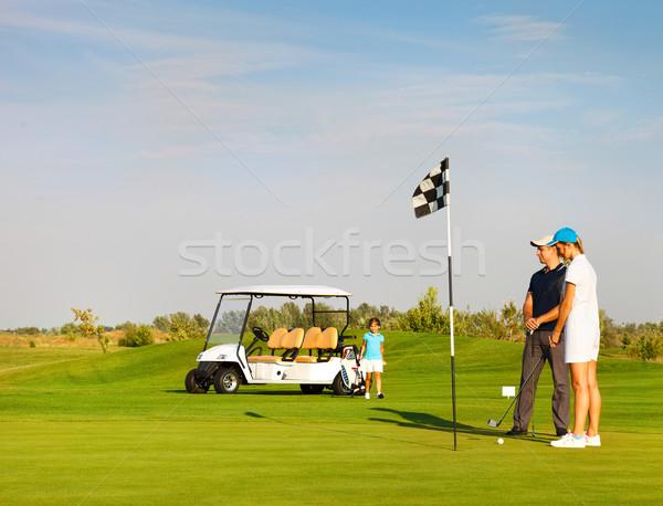 Aile oynama golf golf sahası mutlu aile kadın Stok fotoğraf © dashapetrenko