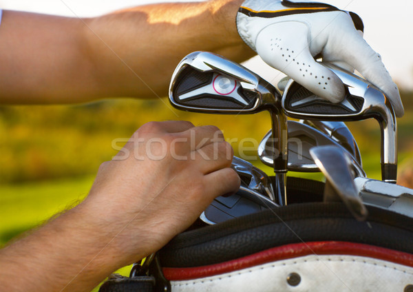 Young man playing golf, choising club Stock photo © dashapetrenko