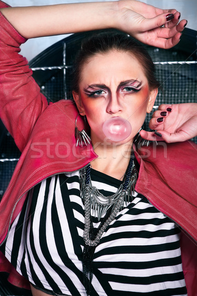 Punk girl doing a bubble with a chewing gum Stock photo © dashapetrenko