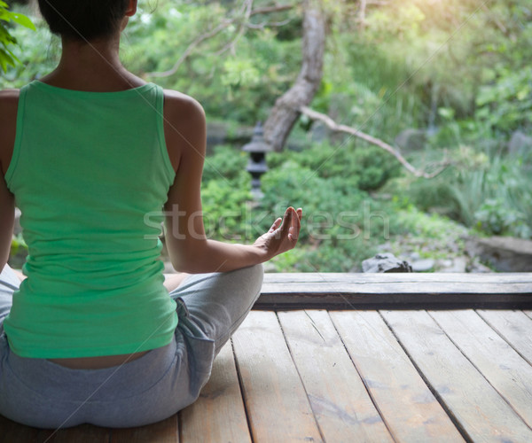 Young woman doing yoga asana in the evening  Stock photo © dashapetrenko