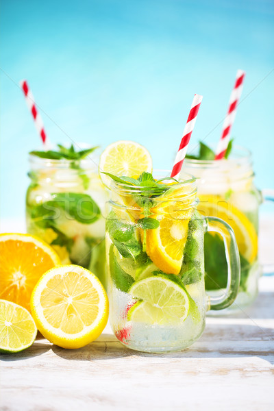 Glasses of citrus lemonade near pool Stock photo © dashapetrenko