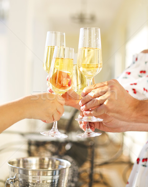 Emberek tart szemüveg pezsgő készít pirítós Stock fotó © dashapetrenko