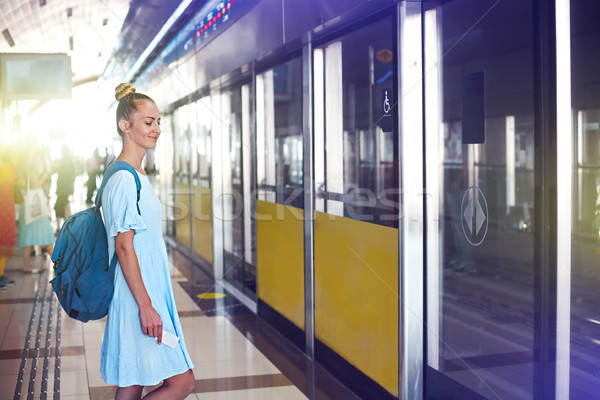 Beautiful happy young woman traveling in metro  Stock photo © dashapetrenko