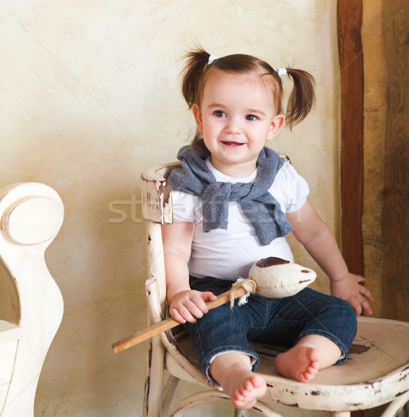 Portré egyéves kislány bent mosolyog baba Stock fotó © dashapetrenko