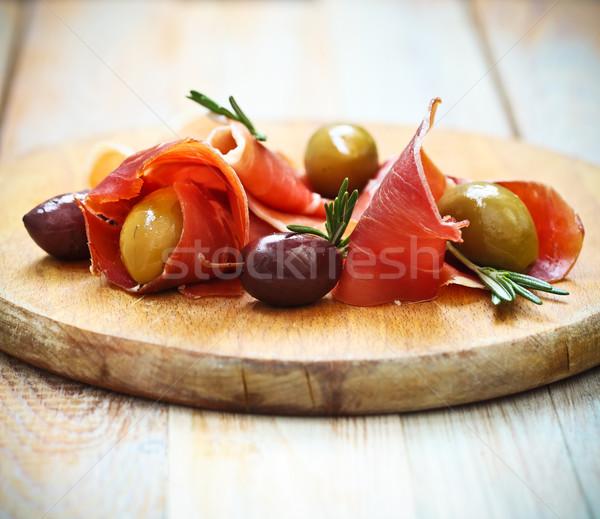 Prosciutto olajbogyók rozmaring fából készült étterem hús Stock fotó © dashapetrenko