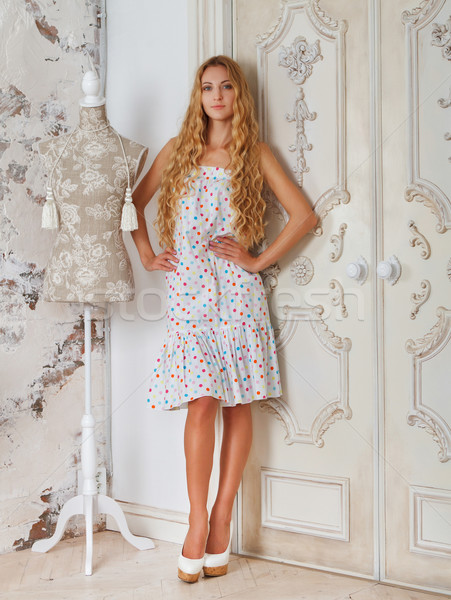 Portrait of the beautiful blond girl in polka dots dress  Stock photo © dashapetrenko