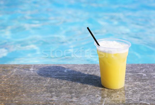 Glass of tropical cocktail on poolside Stock photo © dashapetrenko