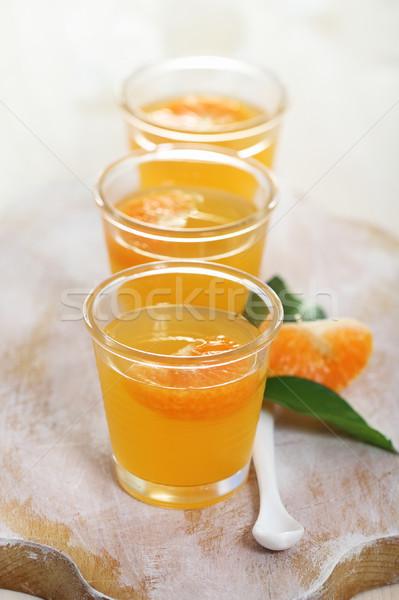 Frutta mandarino gelatina vetro ciotola tavola Foto d'archivio © dashapetrenko