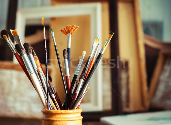 Close up of painting brushes in studio of artist Stock photo © dashapetrenko