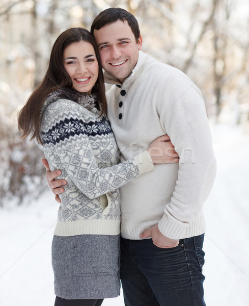 Happy couple with mistletoe having fun in the winter park Stock photo © dashapetrenko