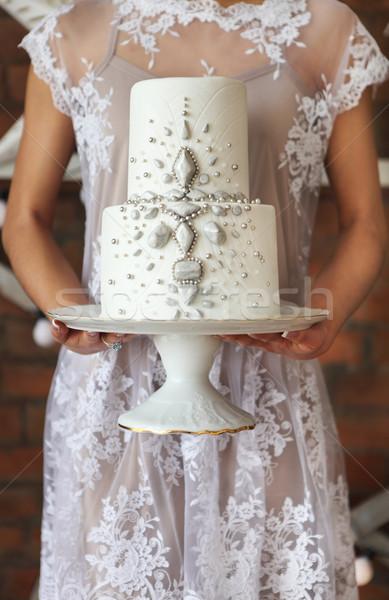Gelin ayakta tuğla duvar düğün pastası Stok fotoğraf © dashapetrenko