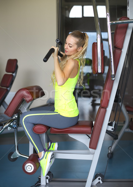 Beautiful muscular fit woman exercising building muscles Stock photo © dashapetrenko