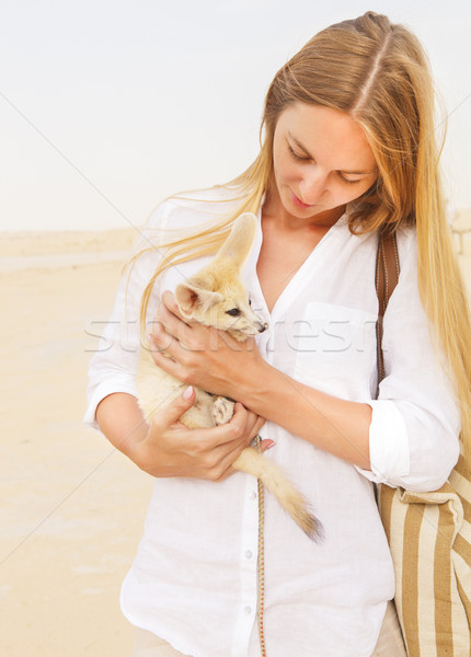Woman holding fennec fox in her hands during traveling in Sahara Stock photo © dashapetrenko