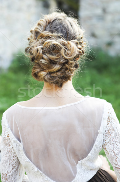 Back view of unrecognizable young woman with blond hair in white Stock photo © dashapetrenko