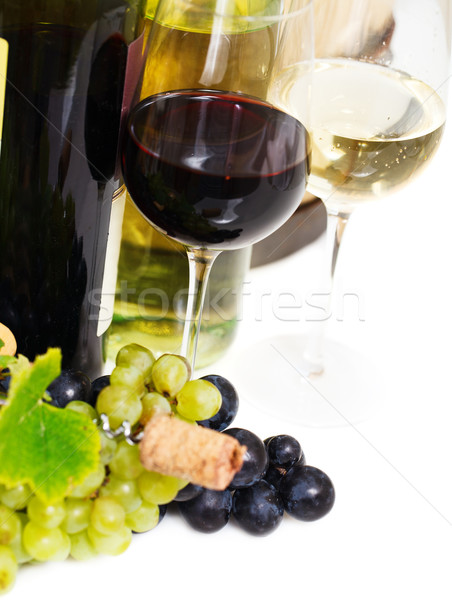 Stock photo: Glasses of white and rose wine and grapes over white