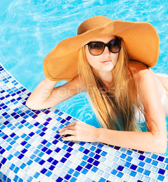 Pretty blond woman in a swimming pool Stock photo © dashapetrenko