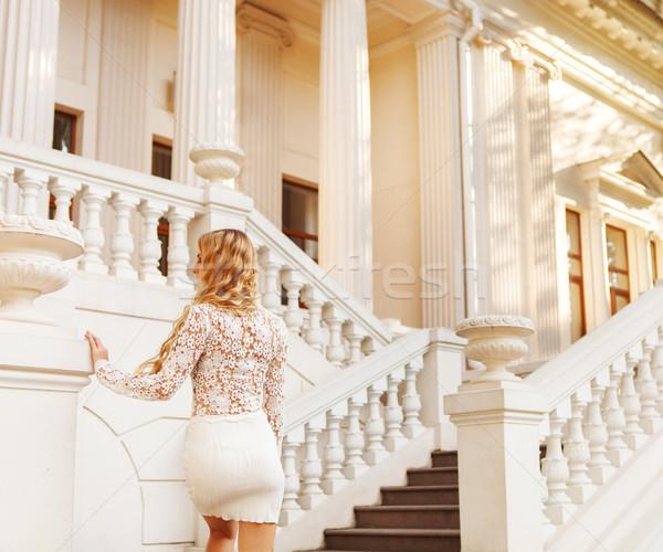 Beautiful blond woman in white dress outdoors  Stock photo © dashapetrenko