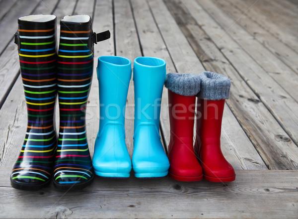 Three pairs of a colorful rain boots Stock photo © dashapetrenko