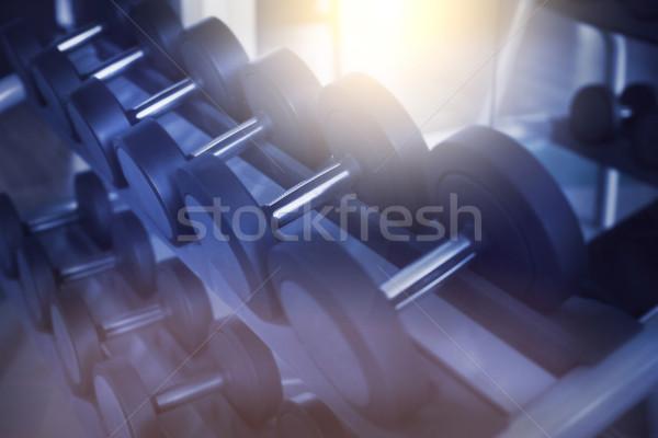 Dumbbells in modern sports club. Weight training equipment Stock photo © dashapetrenko