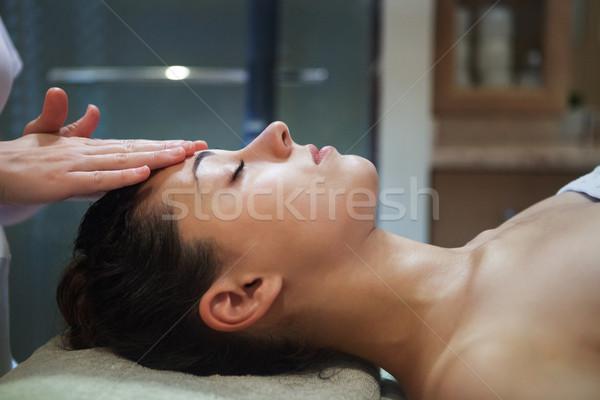 Masseur doing facial massage of an adult woman Stock photo © dashapetrenko