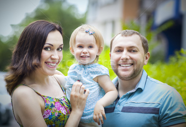 Happy young family with baby girl spending time outdoor  Stock photo © dashapetrenko
