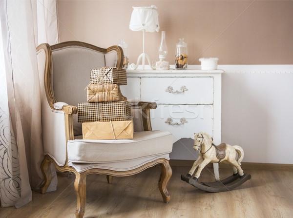 Crianza de los hijos bebé habitación sillón libro Foto stock © dashapetrenko
