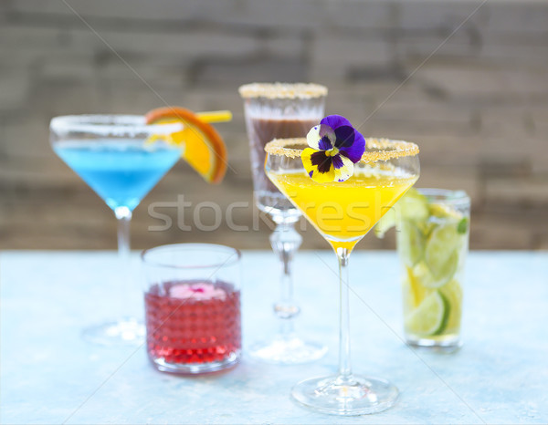 Alcohol cocktails on the turquoise background Stock photo © dashapetrenko