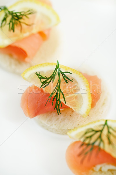 Canapes with smoked salmon and herbs Stock photo © dashapetrenko