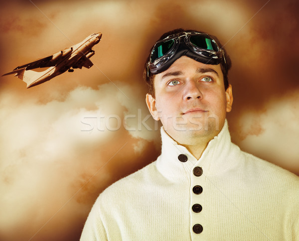 Young man in retro style clothes wearing old-fashioned pilot gla Stock photo © dashapetrenko