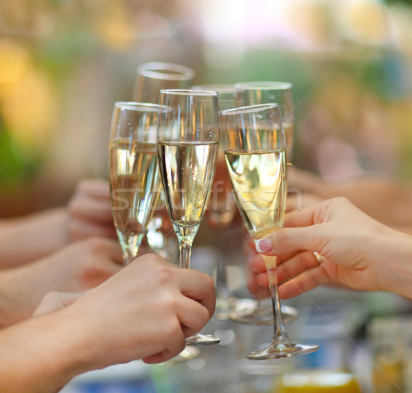 People holding glasses of champagne making a toast Stock photo © dashapetrenko