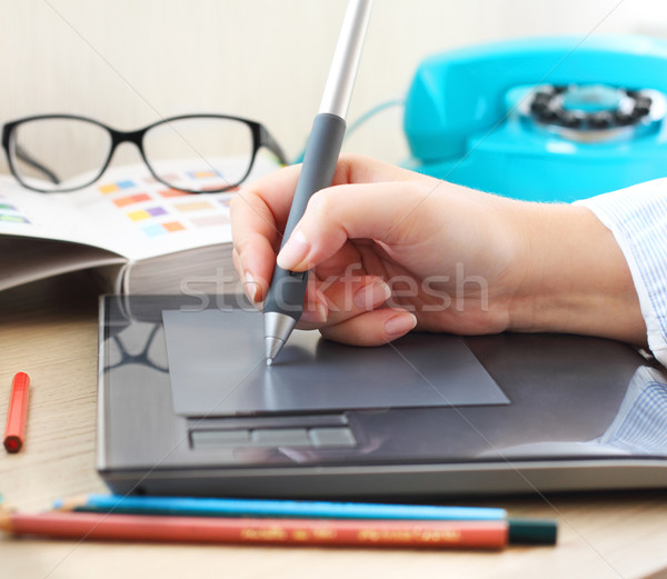 Graphic designer working in office with tablet pen Stock photo © dashapetrenko