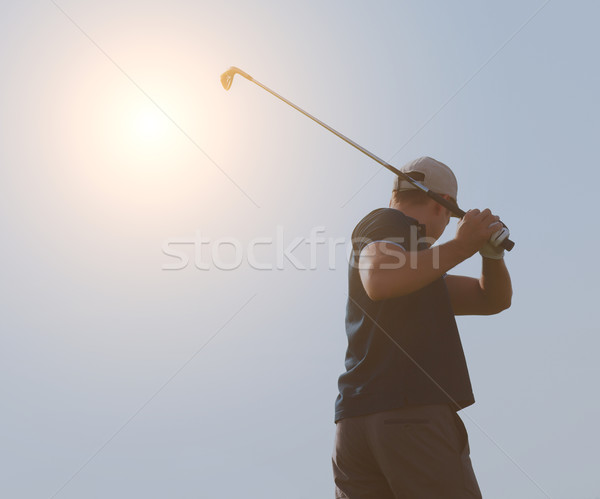 Young man playing golf, golfer hitting fairway shot, swinging cl Stock photo © dashapetrenko