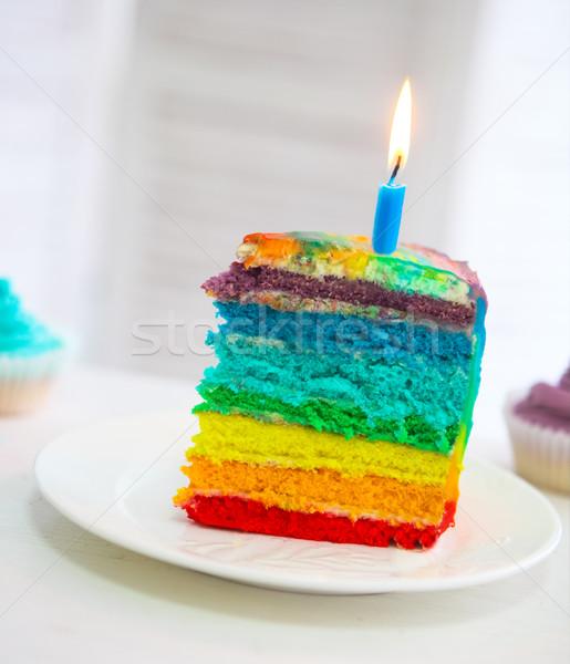 Rainbow gâteau décoré anniversaire bougie table Photo stock © dashapetrenko